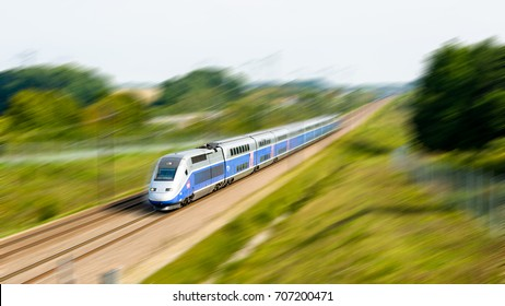 Moisenay, France - August 23, 2017: A double-decker TGV Duplex high speed train in Atlantic livery from french company SNCF driving at full speed in the countryside (artist's impression).
