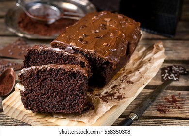Moist chocolate cake with milk chocolate topping glaze and cocoa powder