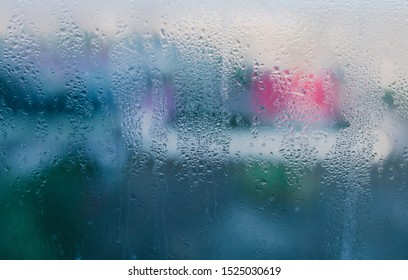 Moist on wet window. Window glass with high air humidity. Background of natural water condensation. High level of dampness in apartment