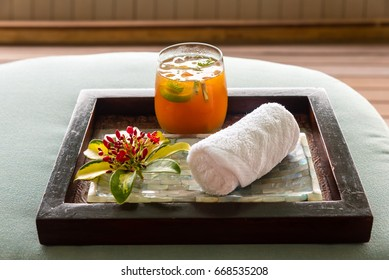 moist towel and refreshing ice tea at a spa