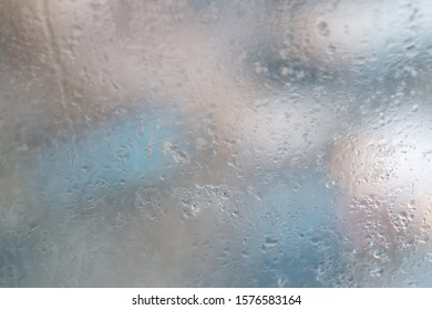 moisture frozen glass. Water droplets condensation background of dew on glass window, humidity and foggy blank background. Outside the window, bad weather, rain