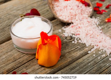 moisturizer with roses on weathered wooden