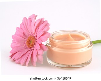 moisturizing face cream with a  pink flower
