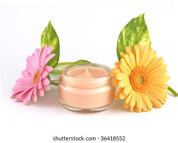 moisturizing face cream with a  pink and orange flowers