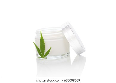 Moisturizing Hemp Hand Cream in dose with Cannabis leaf, isolated on white background. Cannabis cosmetics.