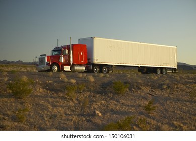 MOJAVE DESERT, CA - JULY 29: 18-wheeler semi-trucks hit the highway driving down Interstate Highway 15 between Los Angeles and Las Vegas Nevada on July 29, 2004 in Southern California