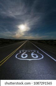 Mojave desert moon over Route 66 sign in eastern San Bernardino County, California.