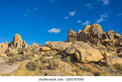 Mojave Desert in southern California holds a pile of boulders deep in the baked wilderness.