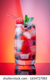 mojito, berry and cola cocktails with lime and ice on color background
