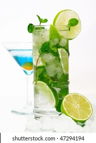 Mojito and blue lagoon cocktails on isolated white background
