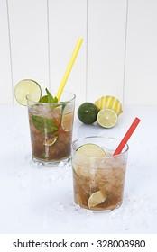 mojito and caipirinha cocktail with lime and ice