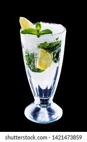 Mojito cocktail at the bar. Mojito cocktail over black background. Cocktail Mojito in the nightclub. Ice cold Mojito.