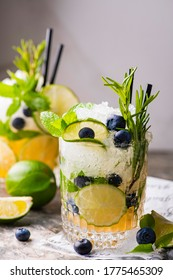 mojito cocktail with blueberry mint and lime
