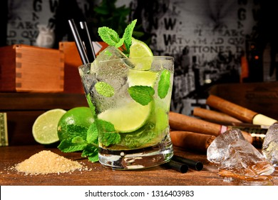 Mojito Cocktail with Cigars on wooden Background
