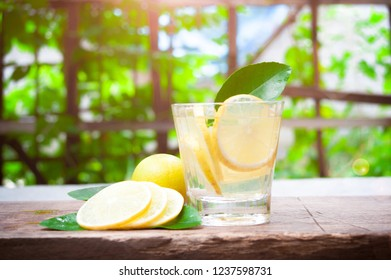 Mojito cocktail in glasses on wooden with tropical nature background, summer drinks