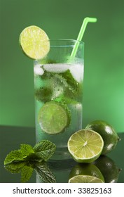 Mojito cocktail with green background