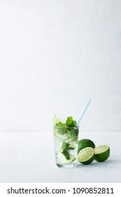 Mojito cocktail with lime and mint in highball glass