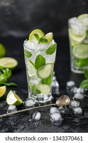 Mojito cocktail with lime and mint in highball glass on a dark stone background. Fresh summer cocktail