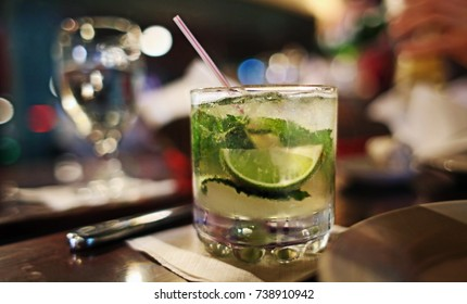 Mojito Cocktail with Mint Lime and Soda Water in Small Glass with Ice