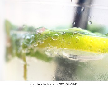Mojito cocktail in a plastic glass close up