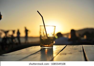Mojito  cocktail at sunset in a beach bar (chiringuito)