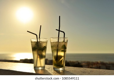 Mojito  cocktail at sunset in a beach bar (chiringuito) on the beach