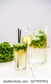 mojito in a decanter. refreshing drink with lime mint.