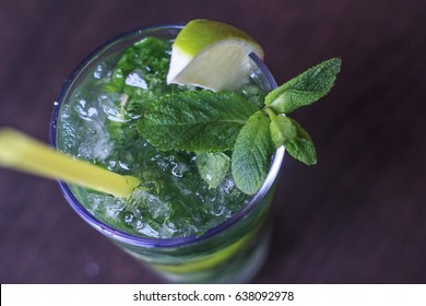 Mojito drink. Mojito with lime. Mojito with straw. Mojito with mint.