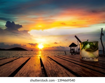 Mojito drinking with sunset in Koh Mak resort, trat, Thailand, this image can use for summer, island, travel, and party concept
