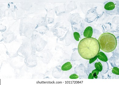 Mojito ingredients, lime and mint leaves, on ice cubes. Cocktail party background. Copy space.