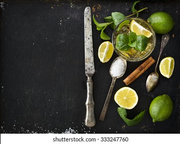 Mojito ingredients on black rustic background