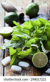 Mojito ingredients on wooden background