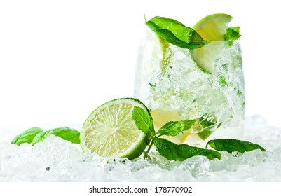 Mojito , lime pieces , leaves of mint with ice and rum , isolated on white