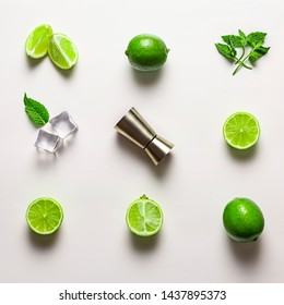 Mojito lime set, flat lay on white background. Ingredients, ice and jigger. Concept: Mojito Cocktail