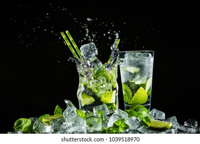 Mojito on ice. Studio photo on a one-color background.