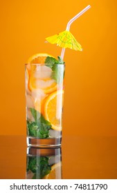 Mojito orange cocktail. on yellow background.