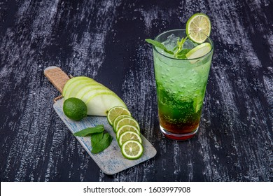 Mojito is a traditional Cuban alcoholic cocktail. Traditional mojito cocktail with white rum, lime, ice and soda in Cuban bar, classic mojito cocktail on the bar.