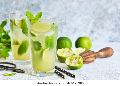 Mojito is a traditional summer cold drink with lime, mint and alcohol. Summer drink.