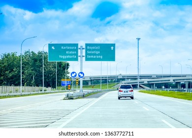 Mojokerto, East Java / Indonesia - Jan 20th, 2019: Traffic Sign Post at Trans Java Kertosono - Solo Salatiga Toll Road, Solo to Salatiga