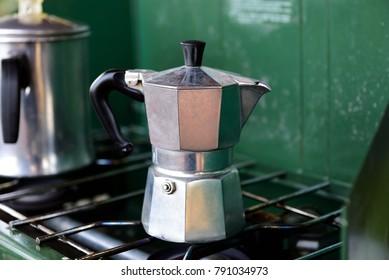 Moka coffee pot boiling coffee on a stove