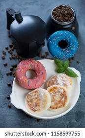 Moka coffee pot with donuts and curd pancakes or syrniki for breakfast, studio shot, selective focus