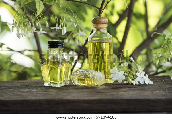 Moke (thai name) flowers, essential oil on natural background.