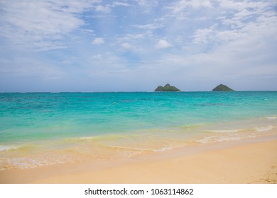 Moks islands in the background at Lanakai Beach on Oahu in the town of Kailua.