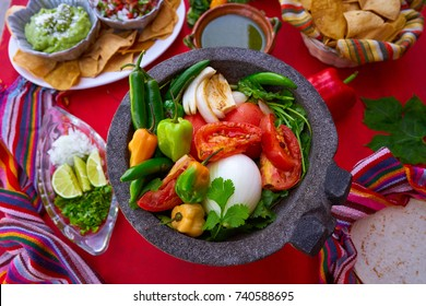 Molcajete with chili for chile ranchera sauce from Mexico