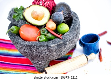 A molcajete is a stone tool, the traditional Mexican version of the mortar and pestle.