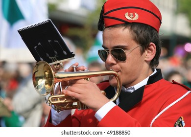 MOLDE - MAY 17: Young man playing the trumpet in the Independence Day, May 17, 2008 in Molde, Norway