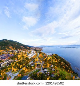 Molde, Norway. Aerial view of residential area in Molde, Norway in the evening. Beautiful fjord with mountains in autumn