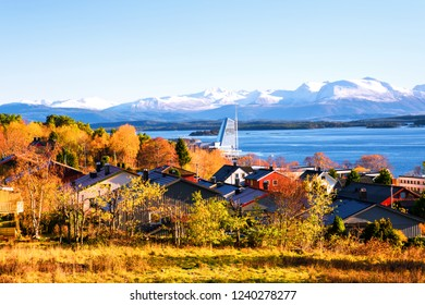 Molde, Norway. Day view of residential area in Molde, Norway during the sunny afternoon. Beautiful fjord with snowy mountains in autumn.
