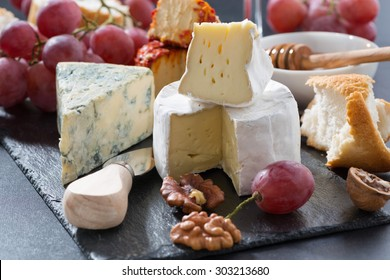 molded cheeses and snacks on the blackboard, horizontal