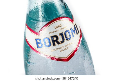 MOLDOVA – FEBRUARY 2, 2017: Cold mineral water bottle Borjomi with drops on white background. Borjomi is the most popular mineral water